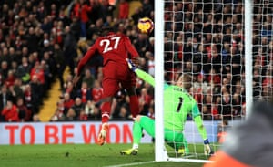Origi connects with the rebound to score and win the game for Liverpool.