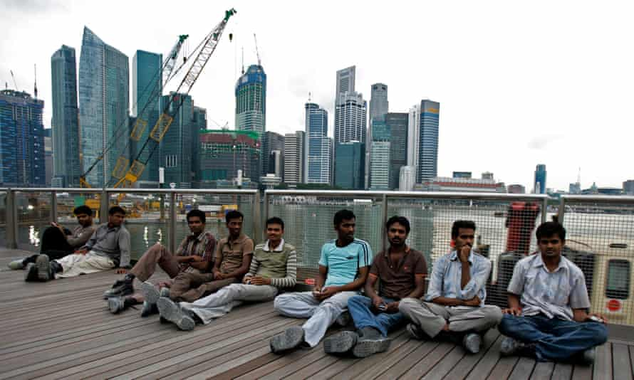 Migrant workers on their day off in Singapore.