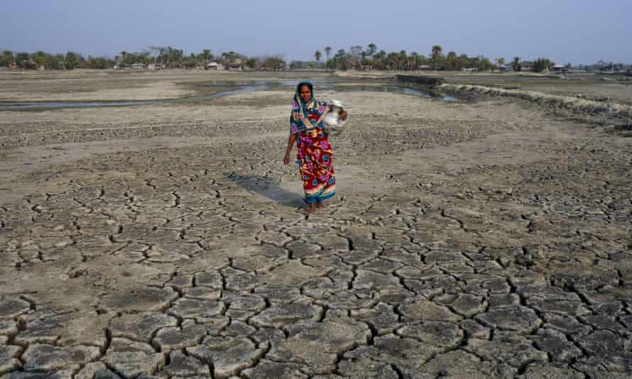 A woman collects drinking water in Satkhira, Bangladesh
