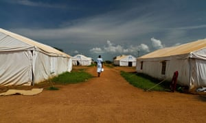 A woman walks in a camp in Juba, South Sudan.