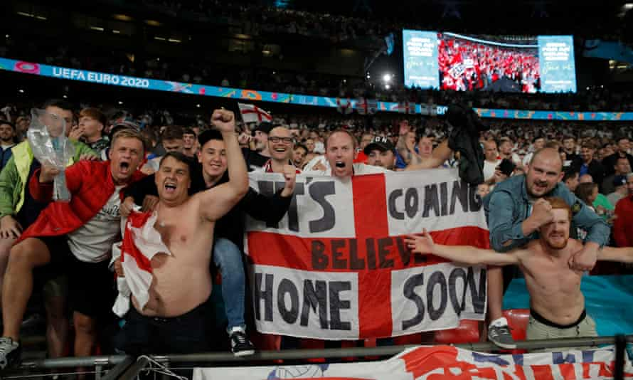 England fans celebrate wildly at the final whistle.