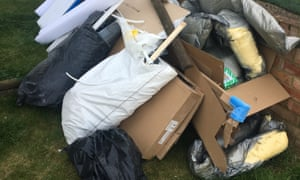 Part of the pile of rubbish in Nicola Milburn's garden that was left behind by Bathstore's fitters.