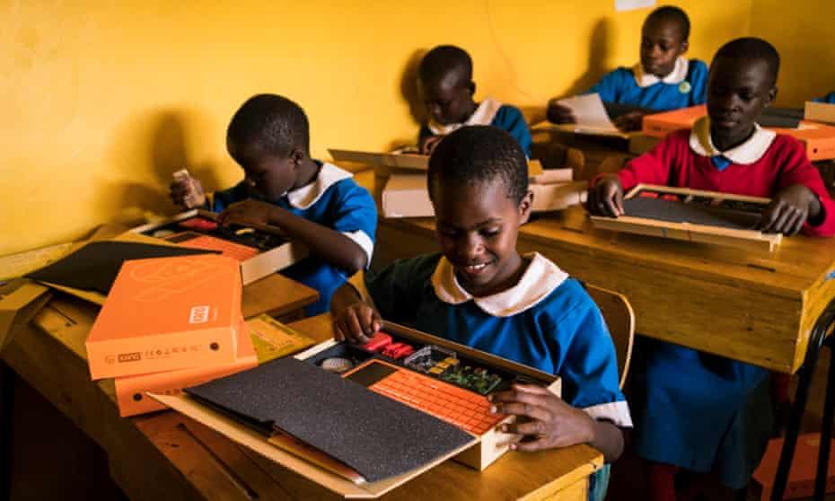 Members of code club start building their computers at a girls school in Kenya