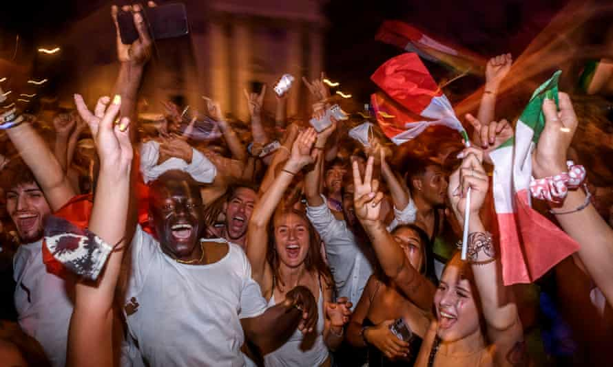 Jubilant fans in Rome celebrate Italy's victory over Spain in the semi-final at Wembley last Tuesday.