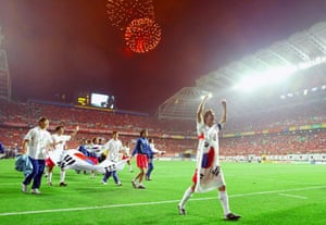 Members of the South Korean team celebrate following their victory over Italy in extra time in the second round of the 2002 FIFA World Cup.