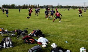 Pitches enjoyed by all, like these Sunday league players on London's Hackney Marshes, are becoming fewer and fewer.