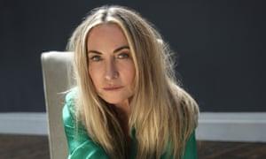 Close-up of Meg Mathews in a green silk top