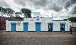 Central Park, home of Cowdenbeath FC. It is one hour before kick-off and the turnstiles have just opened for the new season.