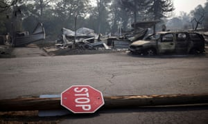 A stop sign is seen at a neighborhood destroyed by wildfires near Bear Creek, Phoenix, Oregon.