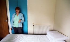 Christine Hughes helps prepare a double bed before the family arrives.