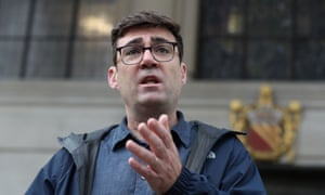 Andy Burnham speaks to the media outside the Central Library in Manchester on Thursday.