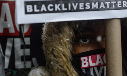 People participate in a Black Lives Matter protest in front of Trump Tower in New York City on 14 January 2016.
