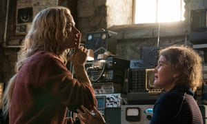 Emily Blunt, left, and Millicent Simmonds in a scene from A Quiet Place.