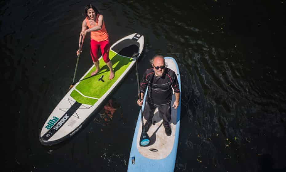 Bill Bailey and writer Zoe Williams go paddle boarding in the Paddington Basin. Photo by Sarah Lee For Do Something