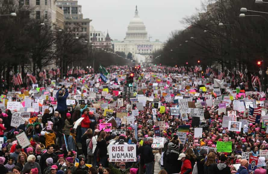 The Mario Tama photo of the Women's March in January 2017. The Archives' version featured a minimum of four anti-Trump signs that had been digitally altered placards.