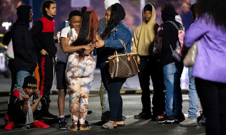 Family members of a shooting victim console each other after two teenagers died following a shooting at Arden Fair mall in Sacramento, California, on Friday.