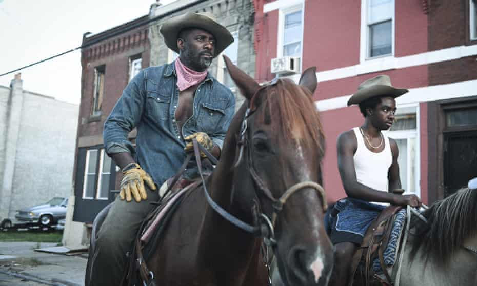 Idris Elba and Caleb McLaughlin in Concrete Cowboy, a gritty drama about a father-son relationship set around the Fletcher Street Stables.