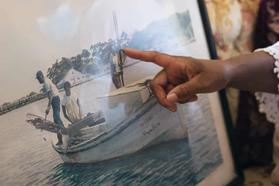 A painting of Black oystermen, including two relatives of Mary Hill, is on prominent display in her childhood home.