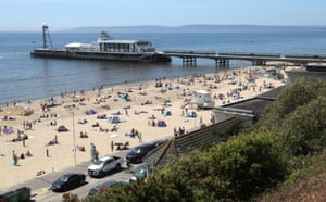 Bournemouth, UK. People enjoy the hot weather at Bournemouth beach, Dorset as the Met Office predicts it to be the hottest day of the year so far