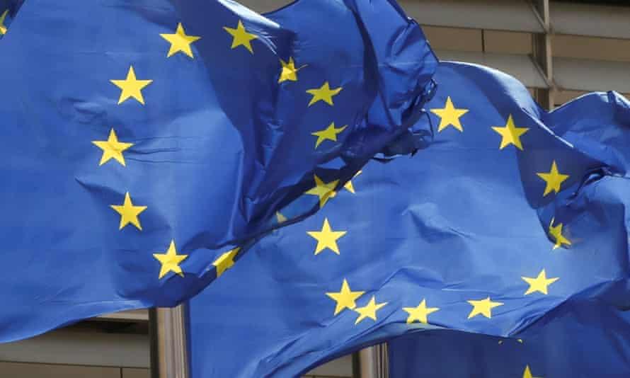 European Union flags flutter outside the EU Commission