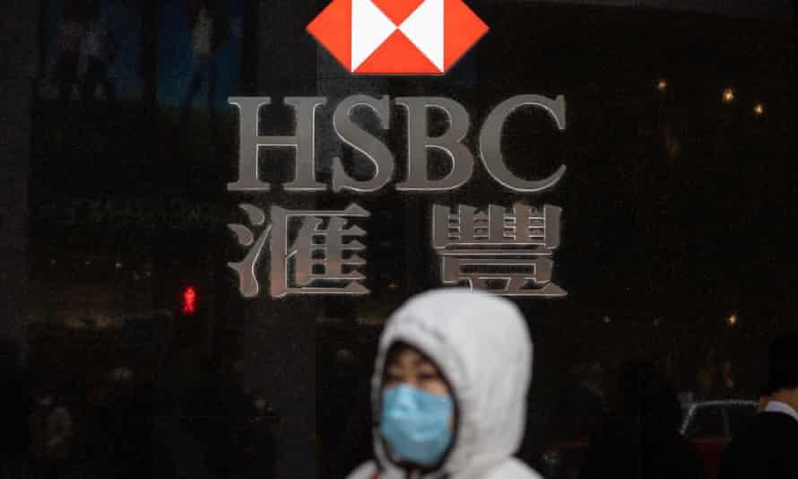 A woman walks past a HSBC branch in Hong Kong.