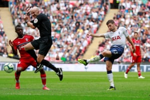 August 18: Referee Anthony Taylor attempts to get out of the way as Tottenham's Ben Davies shoots at goal against Fulham.