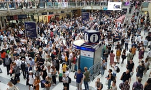 Passengers at Liverpool Street station in London