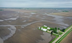 Farmers across the midwest have been losing money for years as climate crisis floods fields and trade wars brought soybeans to below break-even values.