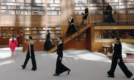 Models wear Chanel's autumn winter 2019-20 haute couture collection on a set designed to look like a library.