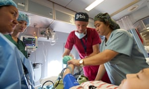 Volunteer anesthetist, Dr. Simon Courtman preps a patient for surgery on the Flying Eye Hospital.