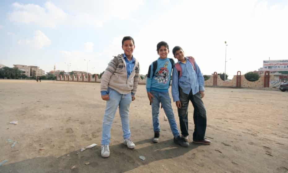 Schoolboys in one of the sprawling open spaces of 10th of Ramadan