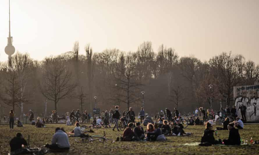 People in the Volkspark am Friedrichshain park in Berlin, Germany, during the warm weather.
