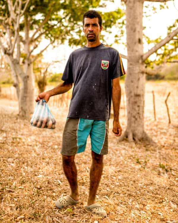 Ricardo, 39, lost his job at a coffee plantation. Though unsteady on his feet, he now sells eggs by the side of the road to support himself and his family.