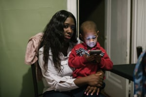 Shanaya Ball sits with her son, Amari, at her home in Philadelphia.
