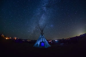 The Milky Way behind a teepee at Oceti Sakowin prayer camp in Standing Rock, US