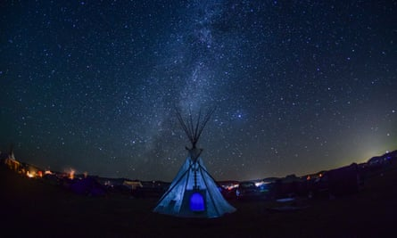 As night falls, the Milky Way begins to form directly behind a teepee at Oceti Sakowin prayer camp, September 7th, 2016.