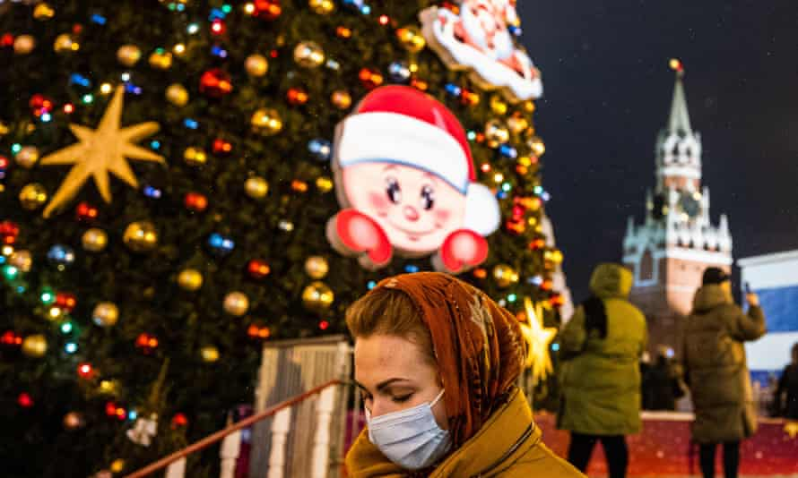 A woman walks past Christmas decorations in Red Square, Moscow.