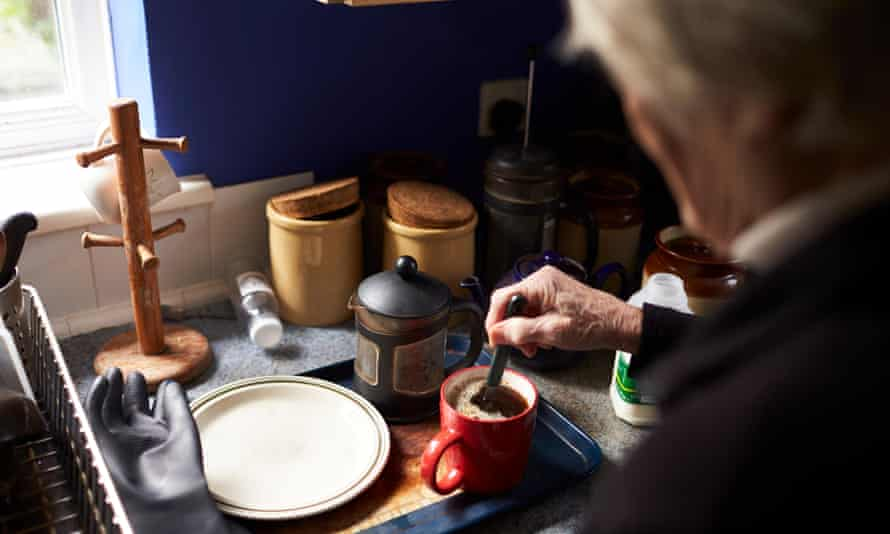 An older person making a drink at home