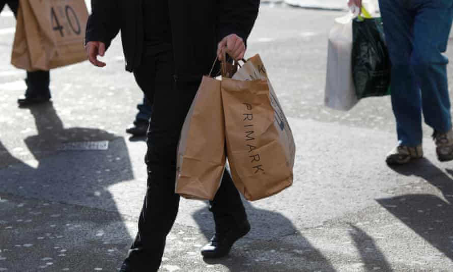 Male shopper with Primark bags