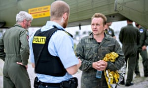 Peter Madsen speaks to a Danish policeman
