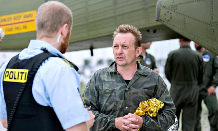 Peter Madsen speaks to Danish police after being rescued south of Copenhagen in August 2017, shortly before his submarine sank