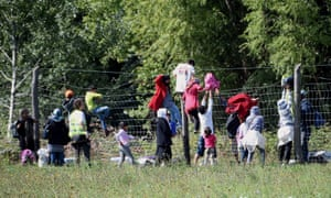 Refugees cross from Serbia into Hungary