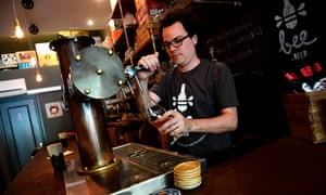 Venezuelan Xavier Losada, 36, works at his bar in Madrid.