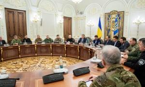 The Ukrainian president Petro Poroshenko leads a security meeting in Kiev