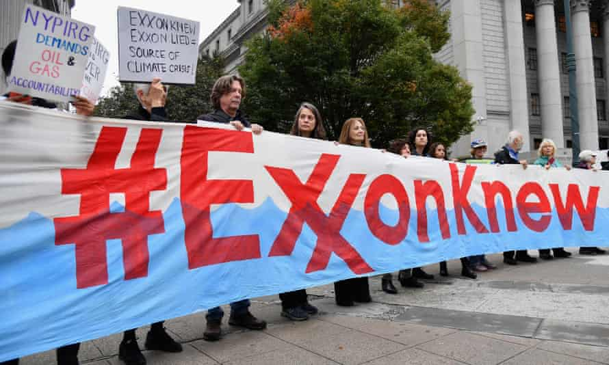 Climate activists protest during ExxonMobil's trial, outside the New York state supreme court building in New York City in October.