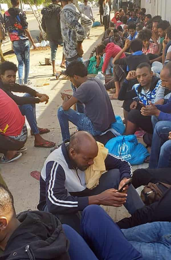 igrants who fled a detention centre in coastal Libya outside a UN facility in Tripoli.