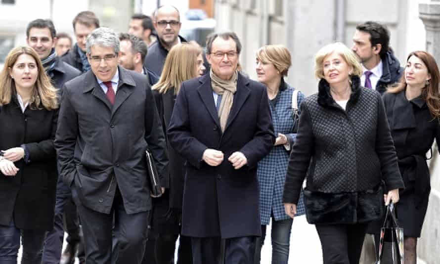 Artur Mas (second right) arrives with colleagues at the supreme court in Madrid.