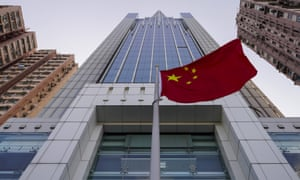A national flag flutters in the breeze outside the China's liaison office building in Hong Kong.