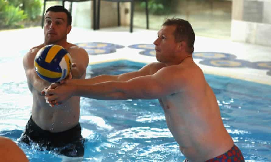 Dylan Hartley (right) and George Ford play pool volleyball during a recovery session at England's hotel in Portugal.