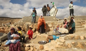 A distraught Palestinian family amid the remains of their home after it was demolished by Israelis in Musafir Jenbah.